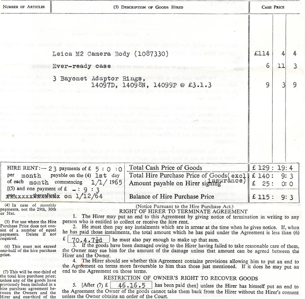 "The guts of the Hire Purchase document that consigned he M2 and accessories to the new owner, Peter M: Note the reference to £70.4s 7½d (seventy pounds, four shillings and sevenpence ha'penny). Typed in triplicate, presumably by R.G.Lewis staff, this ""never never"" agreement was the daily stuff of trade. The three bayonet adaptor rings were to allow the use of existing screw-mount lenses on the new M2"