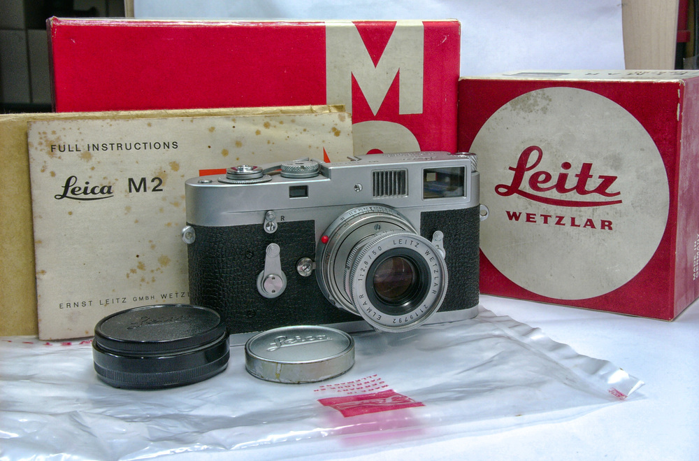The camera in its original box with instructions and the plastic Ernst Leitz bag that would have protected the M2 while in transit