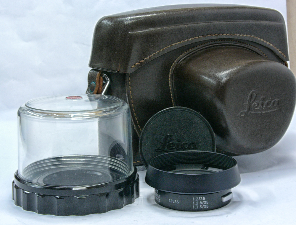 The ever-ready case is looks unused, even after 51 years. The lens hood is also in mint condition and the distinctive period plastic-domed lens protector is perfect