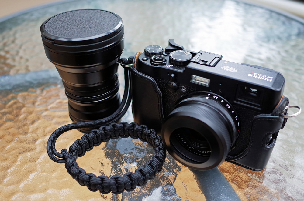 X100T (35mm) with WCL (28mm) and TCL (50mm) with JJC hood and paracord strap (click to enlarge)