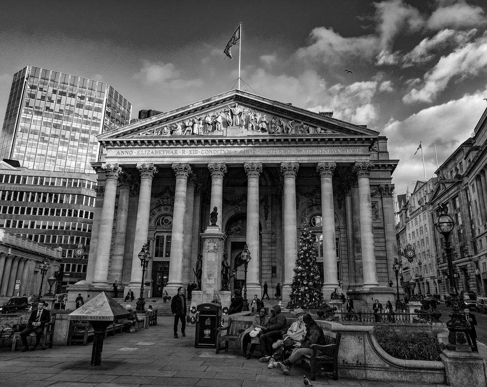 Quite apart from its excellent high-ISO performance, the little Leica D-Lux makes a very compact go-everywhere travel camera. Here it struts its stuff in front of the Royal Exchange building in London (Photo Michael Evans, conversion in Silver Efex Pro)