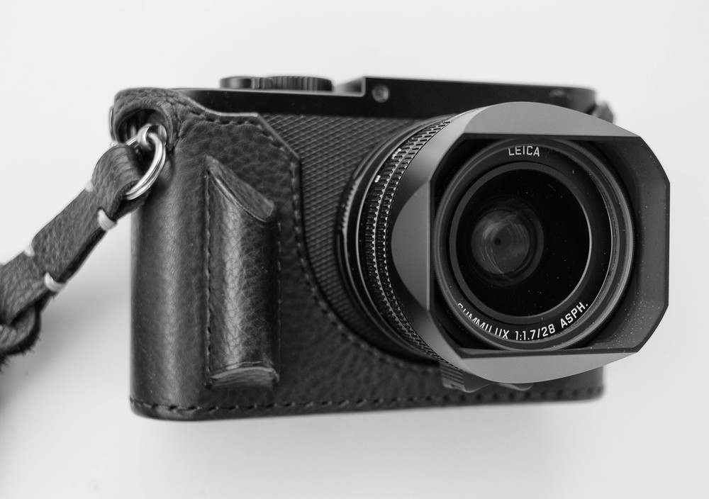 A handsome camera deserves an equally attractive leather jacket: This case from  Arte di Mano  features the Aventine grip which I find preferable to the bulky Leica accessory. The strap is one of  Tie Her Up's  Rock n' Roll plaited leather masterpieces