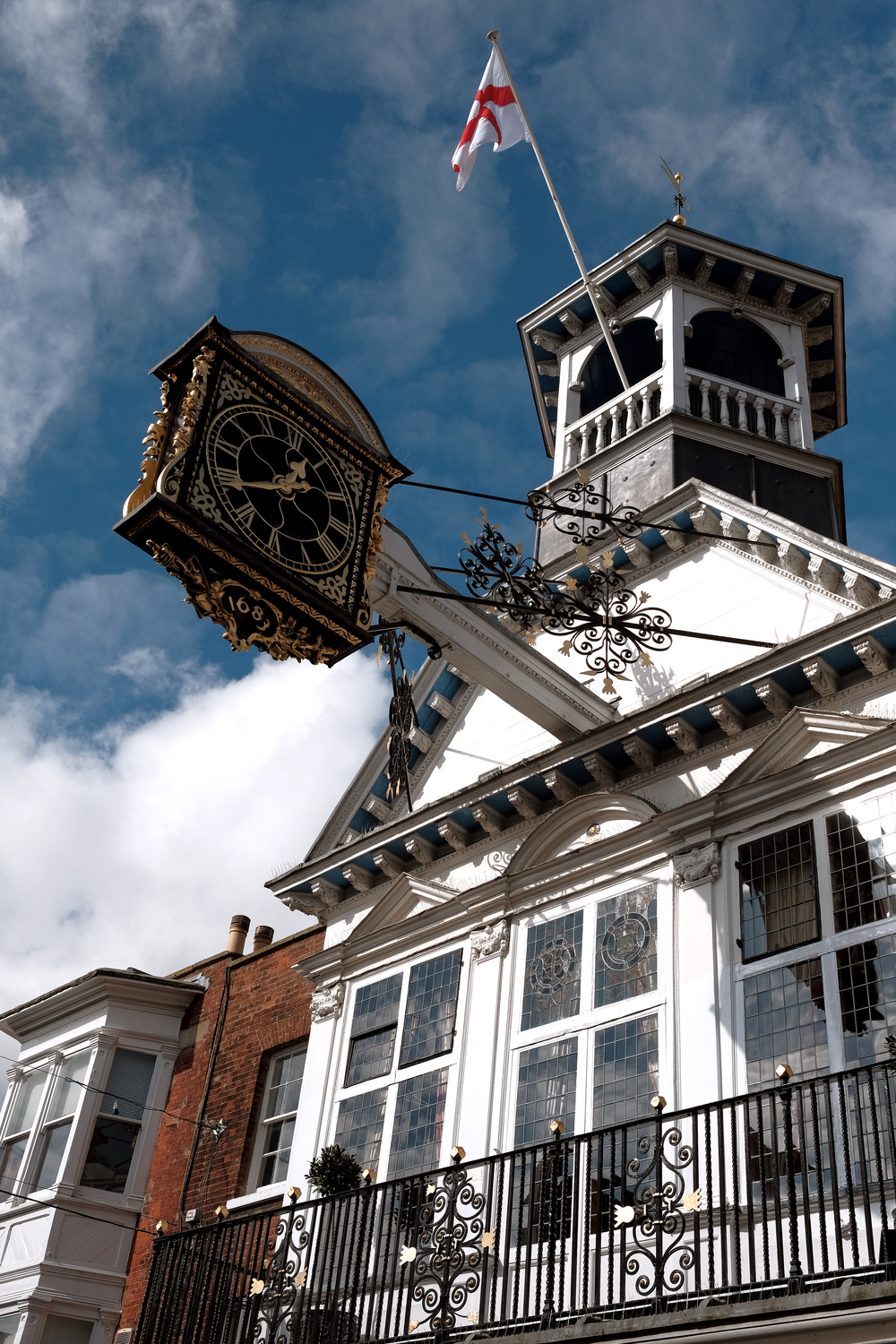 Guildford High Street clock, 35mm f/1.4