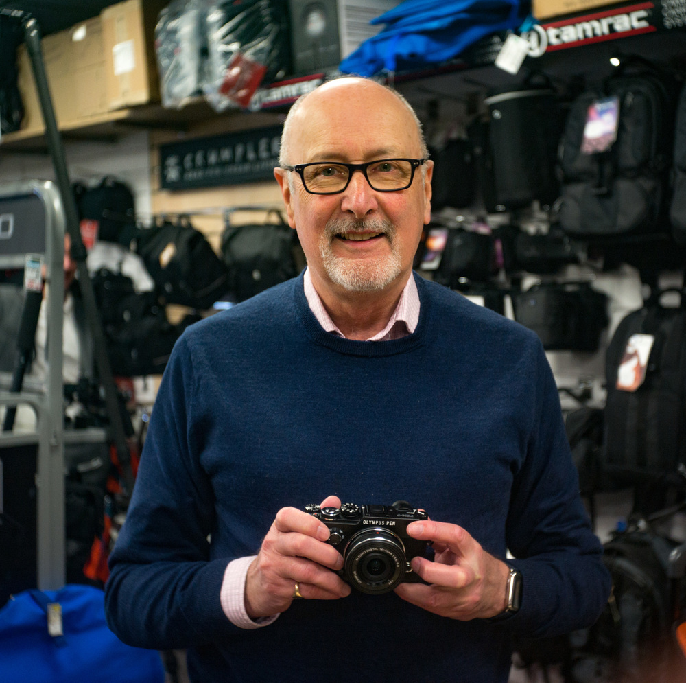 Indoors at ISO 2000 with the Leica M and the 1935 Elmar: Author Mike Evans with the new Olympus Pen. Photo Andy Sands,  Chiswick Camera Centre