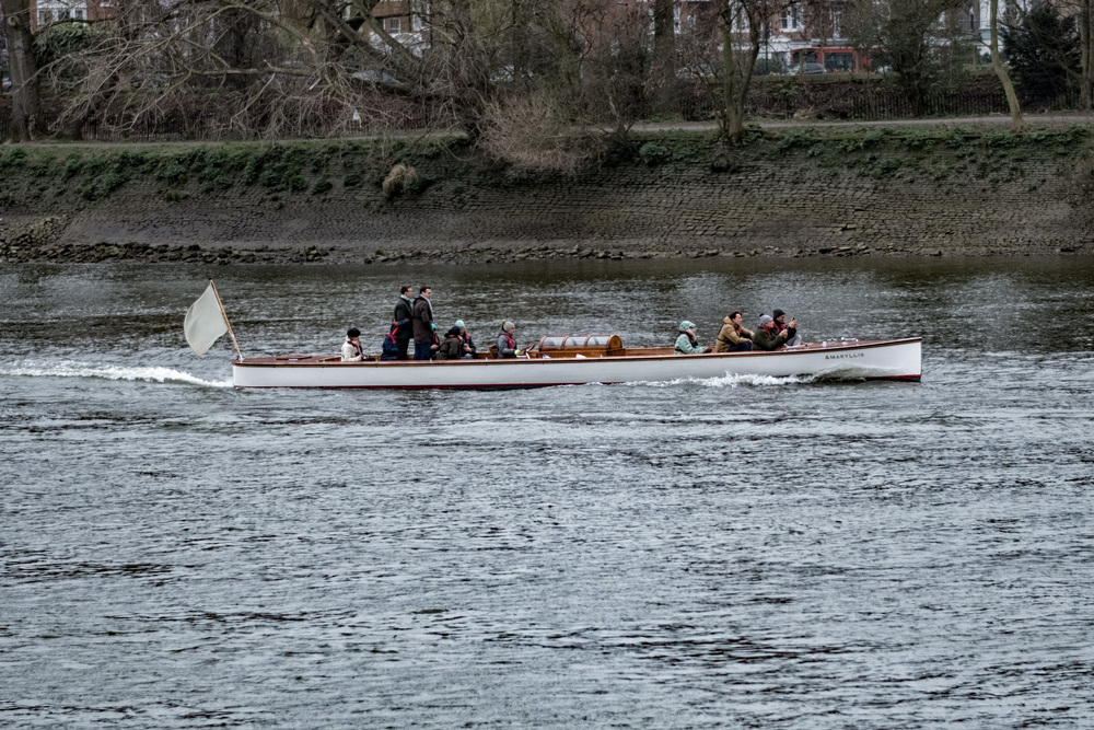 The following launch Amaryllis gives little away with its Thames-grey legendless pennant, but there is at least one passenger in Cambridge colours.