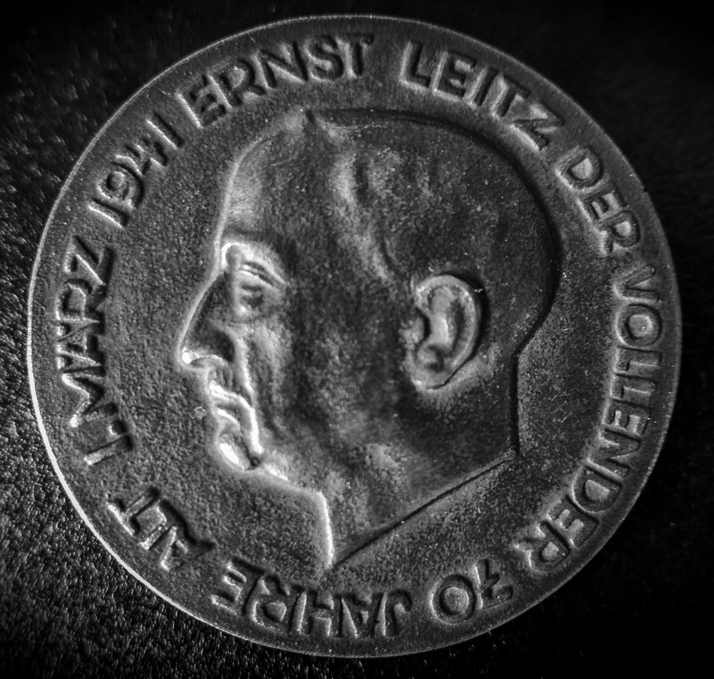 Above: A medal struck by Leitz to commemorate Ernst Leitz II's 70th birthday on March 1,1941. Top, obverse,Ernst Leitz, the founder, 1843-1920. Bottom, reverse, Ernst Leitz II, man who completed the project