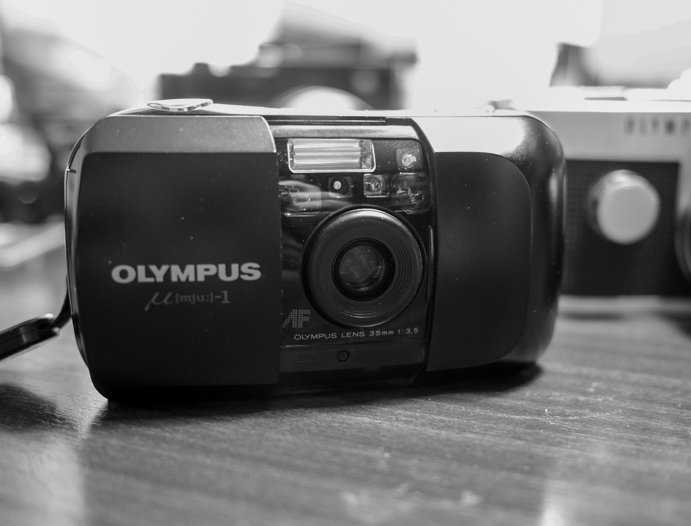 Why did I not buy a Mju-1 when they were all the rage. For some reason the Olympus compact passed me by; but at €20 it is a steal. Fully working, film loaded and ready to go.