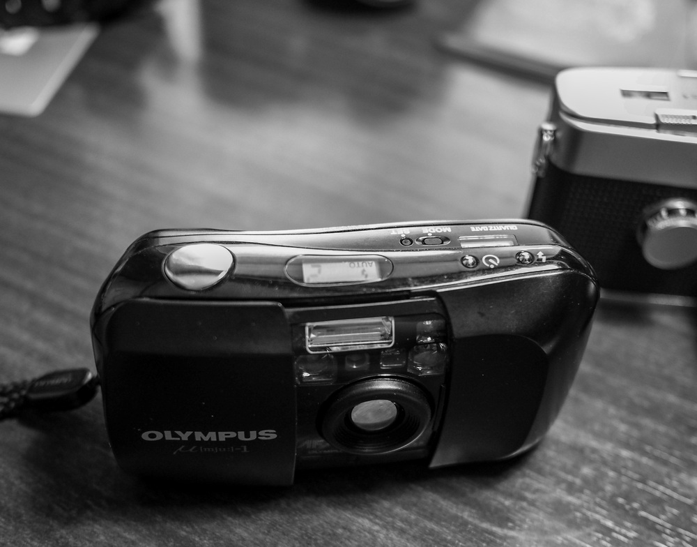 The Mju is a fully automatic point-and-shoot film camera that is easy to set up, easy to load and easy to use. I've had reports that it makes a wonderful street camera.