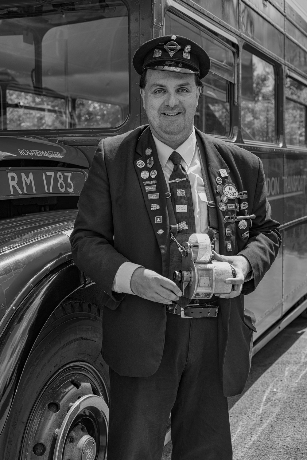 Michael, a former bus conductor, can't keep away from the Routemaster. Here he is in full uniform, festooned with badges and grinding his period ticket machine