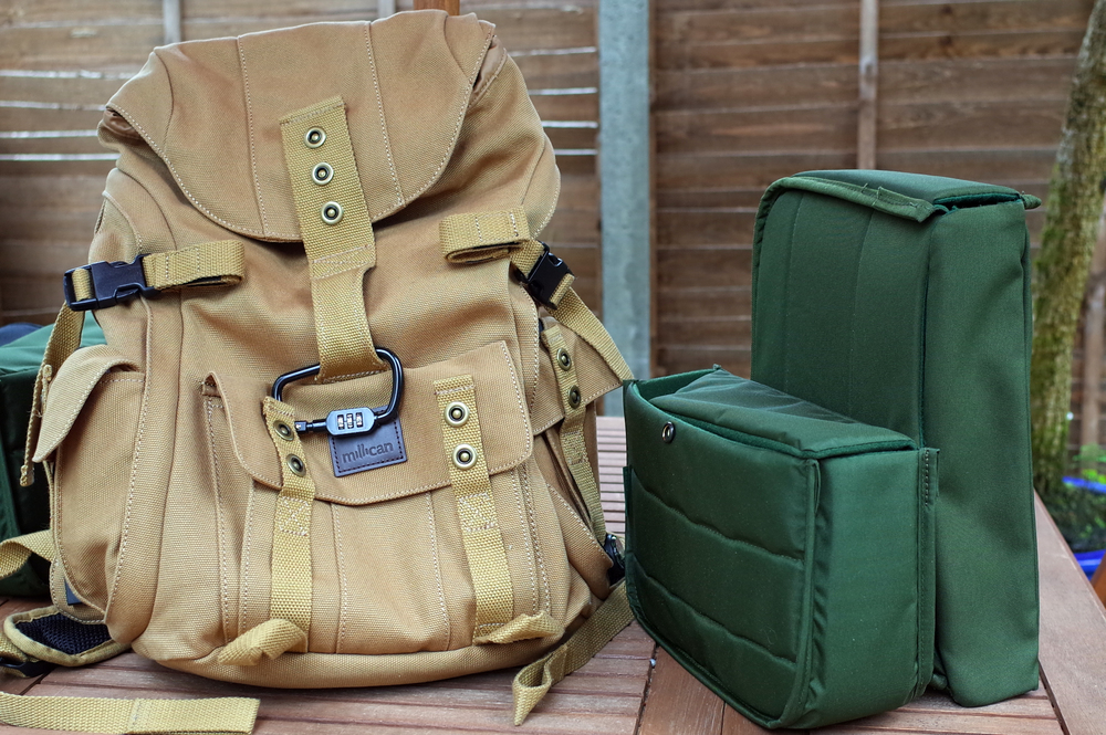 Millican Dave rucksack with two Hadley inserts—Hadley Small and Hadley Pro—to the right