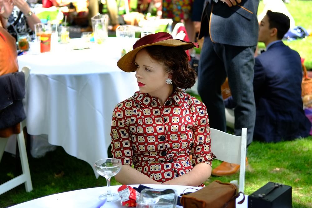 Chap widow with Box Brownie and sadly empty glass