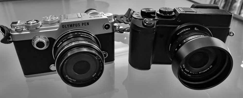 Olympus PEN-F (with Oly 17mm f/1.7) compared with the Panasonic Lumix GX8 with the Leica DG 15mm f/1.7. The Olympus lens has that brilliant push-pull focus clutch with a helpful depth-of-field scale in the manual position. The Leica lens makes do with a simple AF/MF switch but adds a beautifully smooth and precise manual aperture ring.