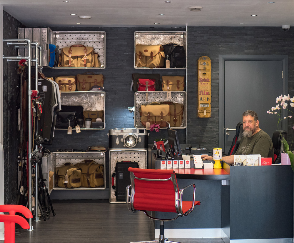"Ivor Cooper at the all-new Red Dot Cameras store in Goswell Road, City of London: ""Brexit has added at least ten percent to the cost of accessories imported from abroad."" The British-made Billingham bags in the background belong to one of the few ranges that will not see immediate price increases."
