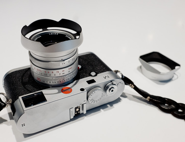 Thorsten's 35mm Summilux FLE ventilated shade with the Leica standard hood shown to the right (Photo Thorsten von Overgaard)