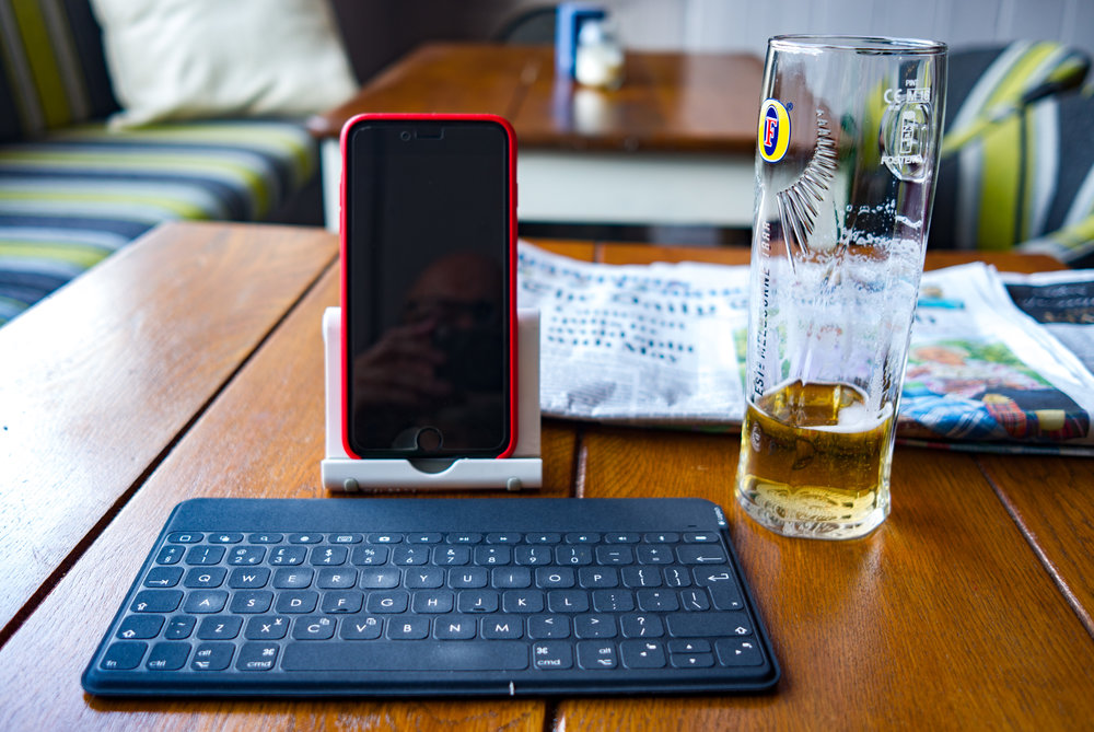 Quart into a pint pot: The minimal writer's workshop in the form of iPhone Plus, plastic prop stand and Logitech's touch-perfect Keys-to-Go keyboard.