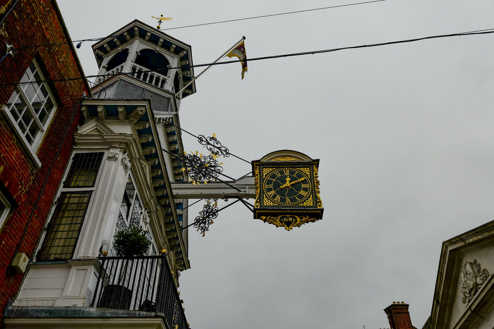 Where would Guildford be without the High Street clock? But someone with clout should chop down those cables (Leica SL)