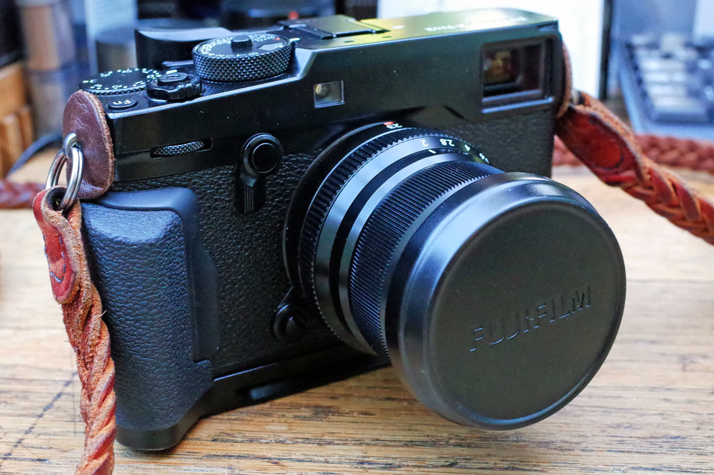 The X100T's lens cap fits the new 23mm f/2