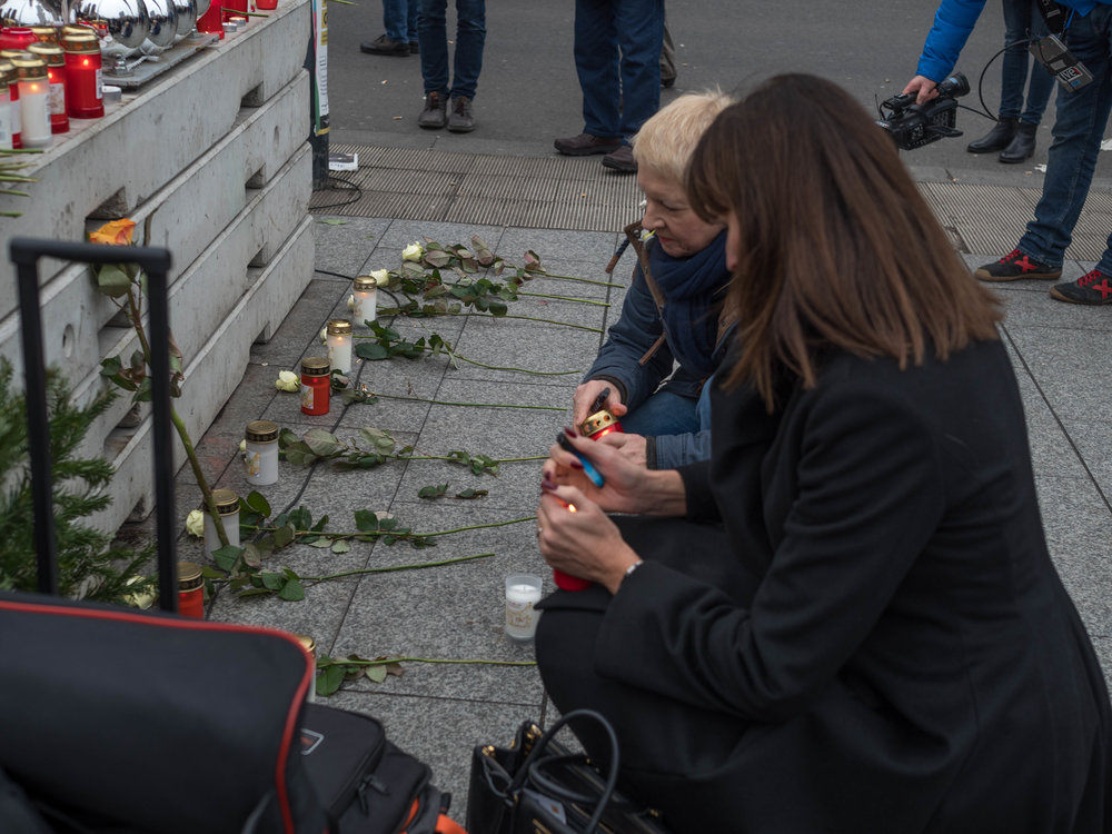 Another atrocity, another memorial of candles and flowers