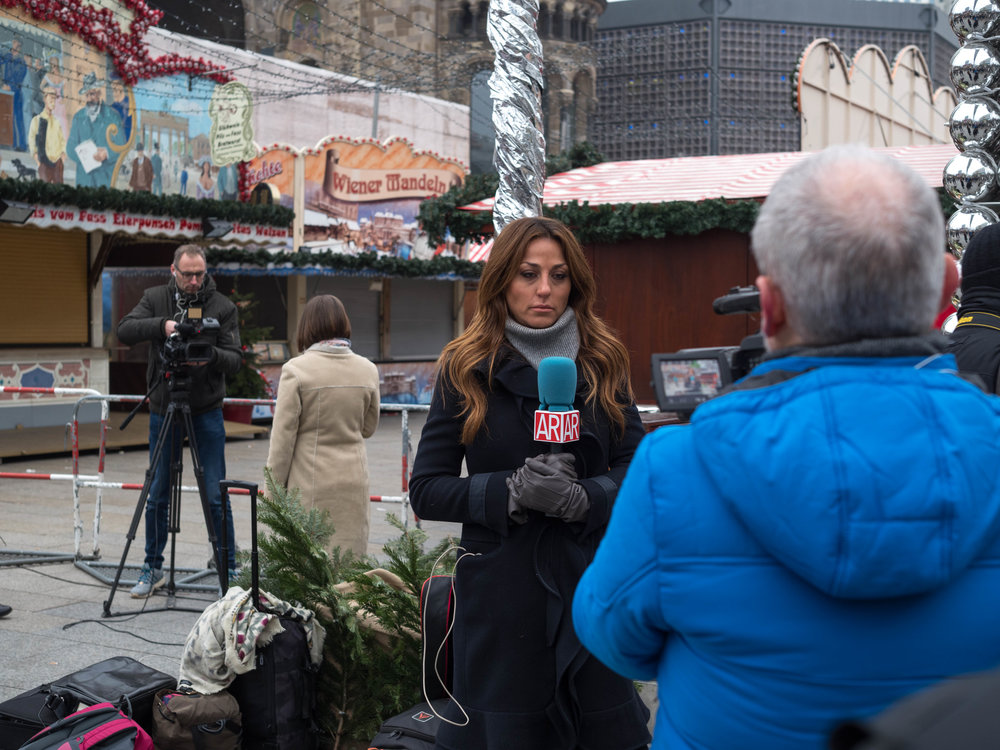 The world's press has replaced the happy crowds at one of Berlin's leading Christmas markets.