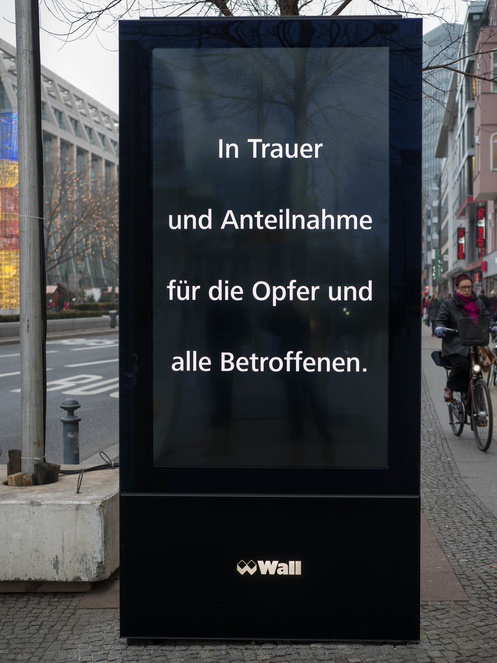 A simple message of sympathy replaces all the advertising displays in the city