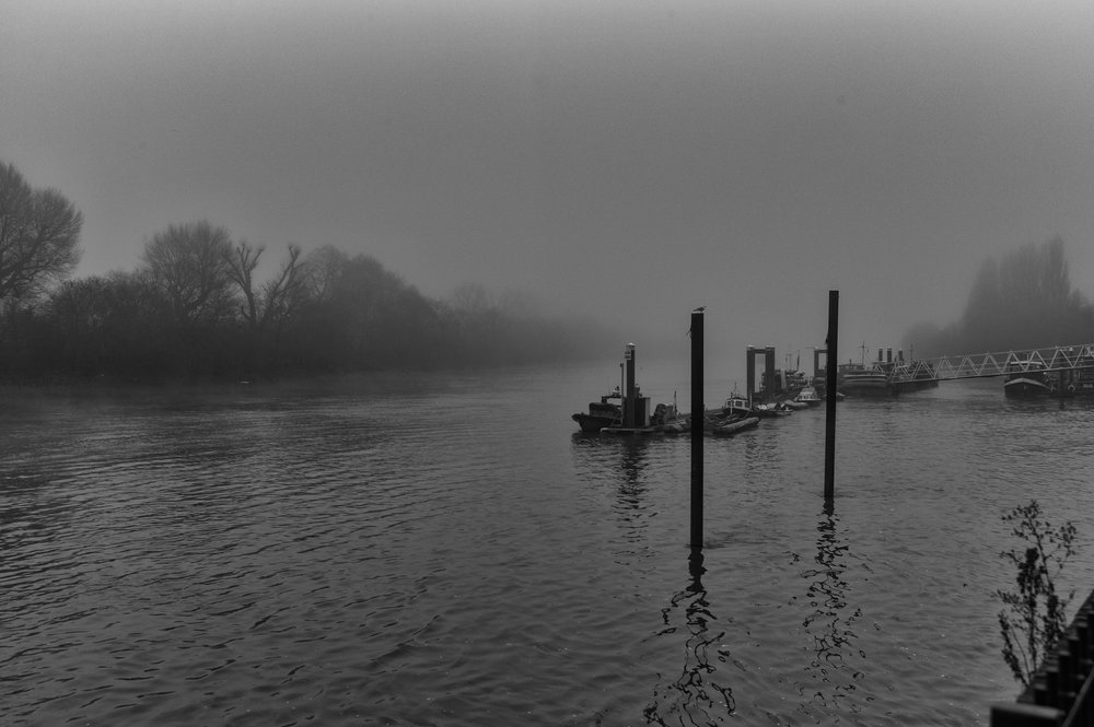 Lifeboat station at Chiswick Pier shrouded in typical winter mist