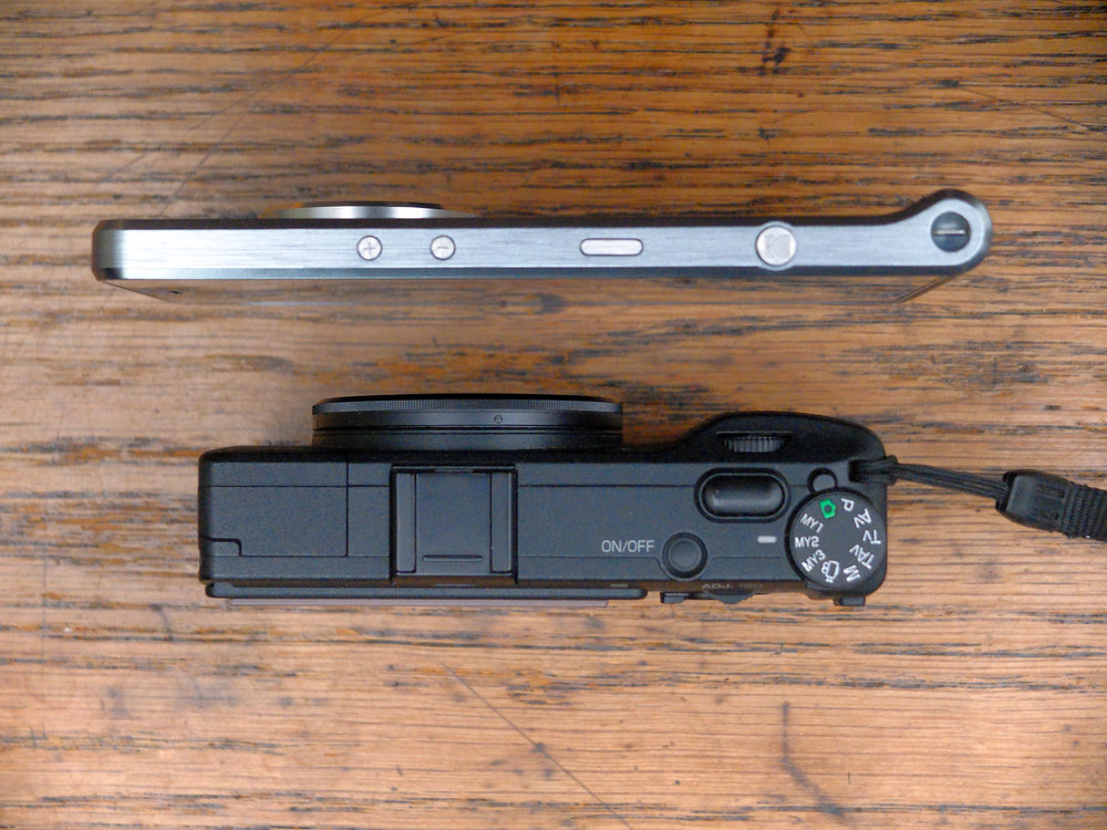 When thinness isn't everything: The Kodak Ektra shapes up against the fuddy-duddy Ricoh GR.