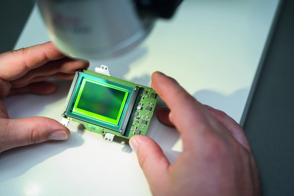 Sensor surface and coating are visually examined for scratches, dust and air pockets