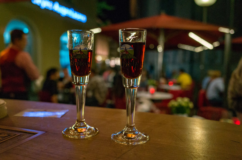 The Ricoh is a camera you can keep in your pocket for an evening out on the town, whether at home or on vacation. This Bavarian Schnaps-shot taken at ISO 4500 (Mike Evans)