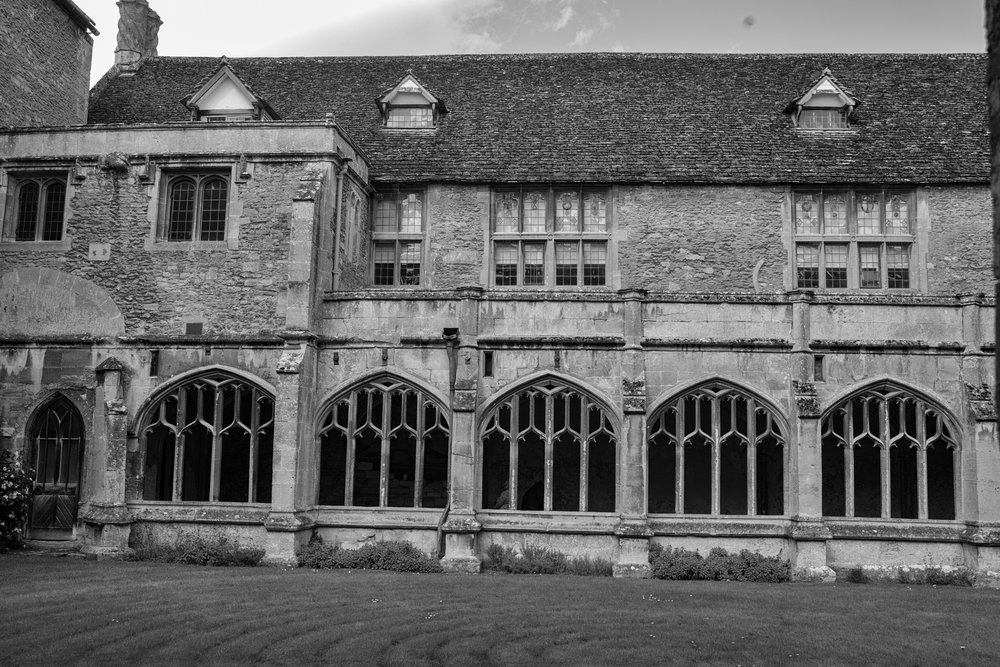 "The original 13th-century abbey cloister with William Sharington's ""modern"" Tudor residence perched above"