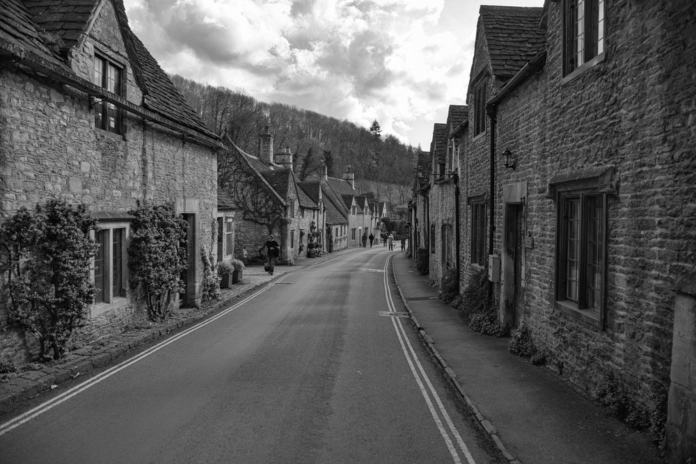 Above: Castle Combe claims to be the prettiest village in England, preserved from the motor car by the double yellow line. Below: Centre of the village, not a car in sight. Who needs Disneyworld when this is on your doorstep?