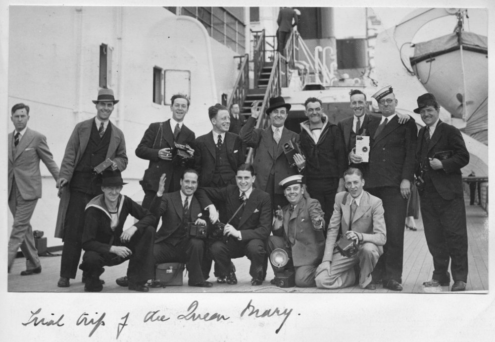 [Fig.7] Press Photographers aboard The Queen Mary on its trial trip, circa 1936. The cameras have been enlarged below to show more detail. Numbers 1-3 show the row standing at the back from left to right. Numbers 4-7 show the row kneeling from right to left. One is using a flash bulb. Click on the inividual images to see full size