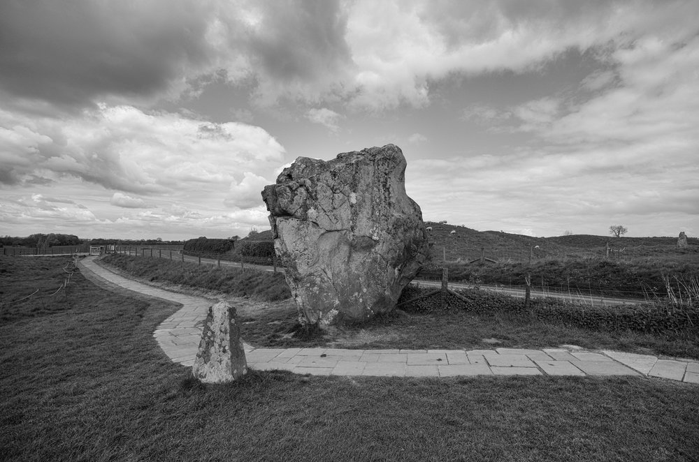 Dramatic landscapes benefit from a wider angle. Ancient stone at Avebury, Wiltshire, taken at 11mm, f/3.5