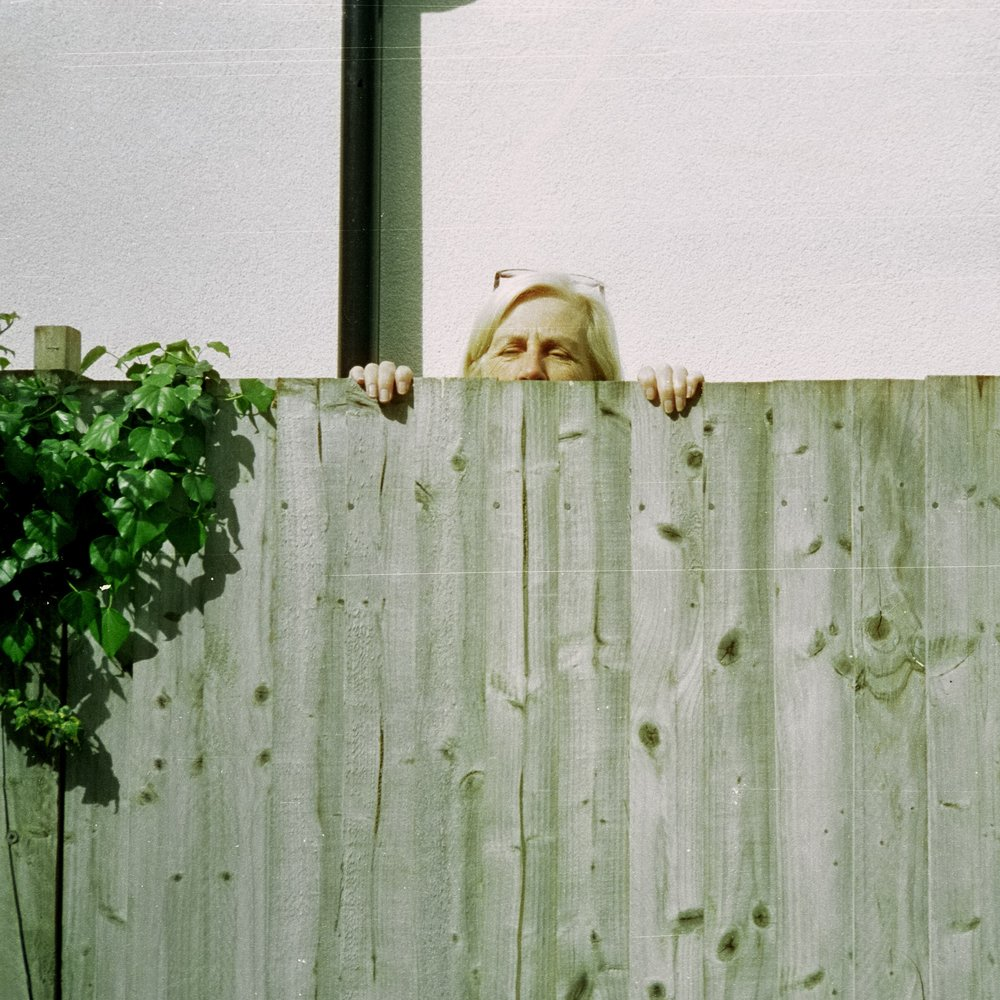 My missus was looking after the children next door when she heard me discussing plumbing or something with a friend. She poked her head over the fence and I quickly snapped with the XA
