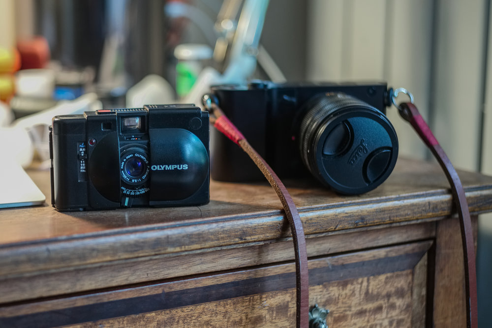 Temporary nirvanah — the Olympus XA has a lot more potential as a pocketable film camera. It has a 35mm fixed f/2.8 lens and proper rangefinder focus. And the bashed-up Leica T is proving to be a great digital contender