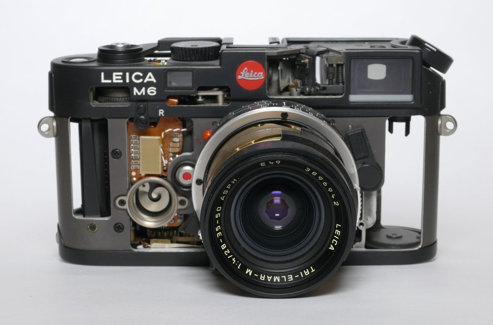 A Schnitt Leica M6 with a cutaway Tri-Elmar-M. The interesting thing here is that this lens is in full working order, despite its skeletal appearance. It reminds me to handle mine with extra care!
