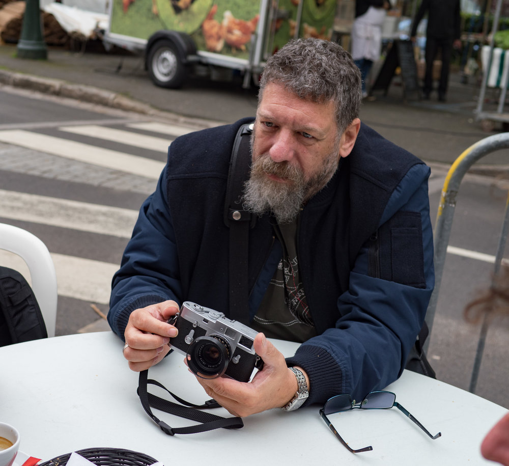 Ivor Cooper of London's Red Dot Cameras examines a tidy M2 that an itinerant seller offered over the croissants before the fair had even started.