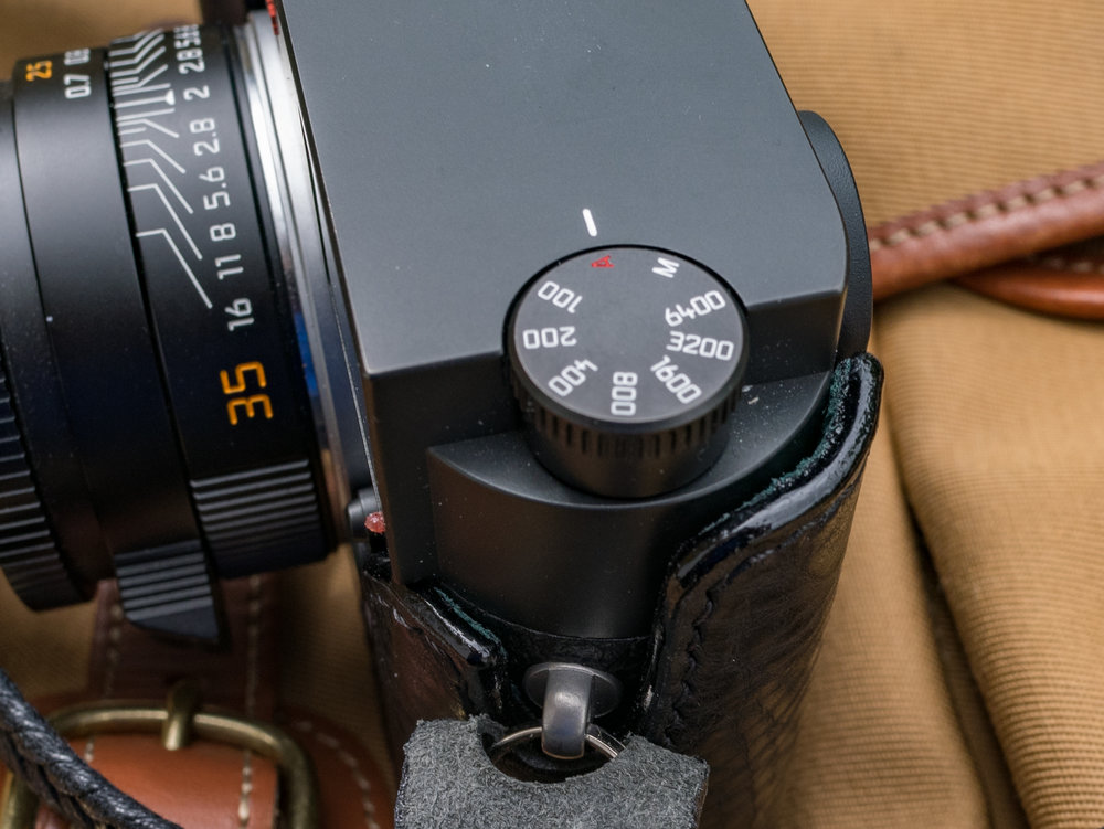 The protective leather extends to the base of the ISO dial while on the other side it reaches to the top of the camera