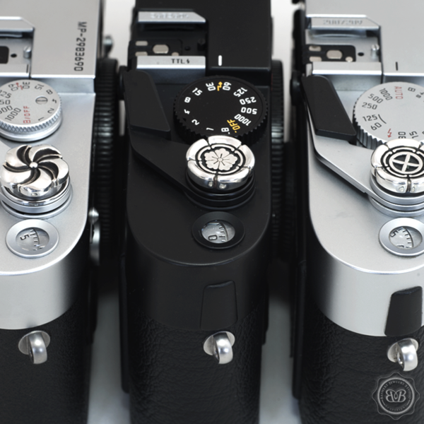 Nice cameras.... Bashert Jewelry can trick out your film M or even your digital M with a silver release button in a range of interesting designs