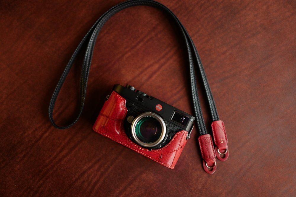 Bold red with complementary black/red waxed-cotton strap, standard grip