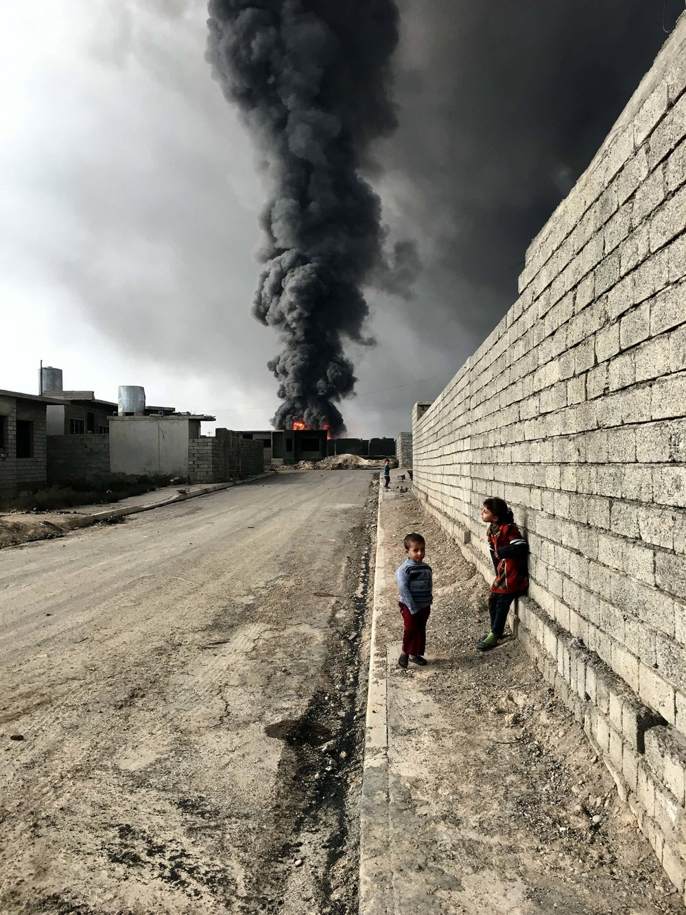 Overall winner: Sebastiano Tomada of New York City took the grand prize and was photographer of the year for a shot of children in Qayyarah, Iraq, near fire and smoke billowing from oil wells set ablaze by Islamic State militants