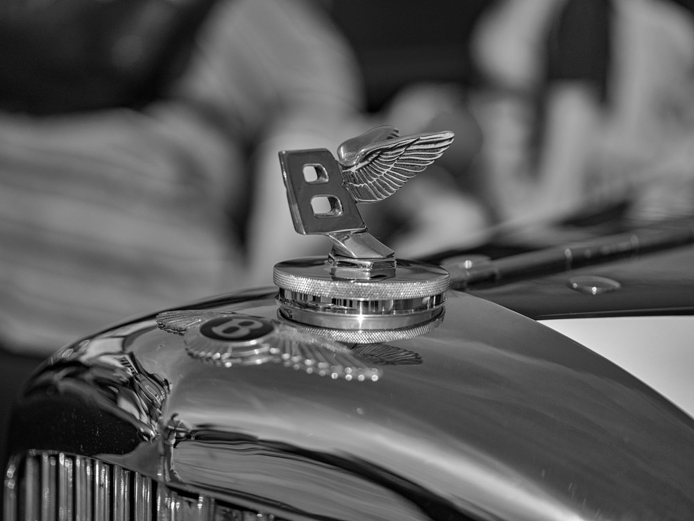 Bentley was almost synonymous with Brooklands in the 1920s and 1930s (42.5mm Leica DG Nocticron at f/1.2, a touch of bokeh from this fast micro four-thirds lens. It offers roughly the same depth of field as a full-frame 75mm Leica Apo Summicron)
