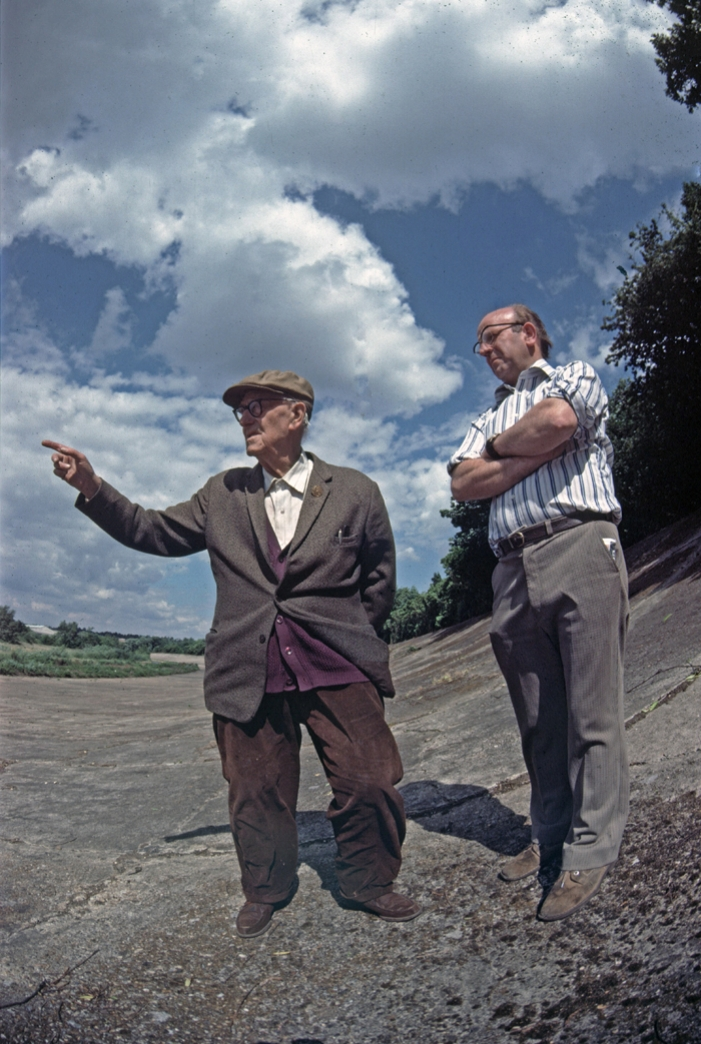 "Bob Dicker and Jim Young on the Brooklands banking. Bob is wearing his Brooklands Gold Star which was awarded for lapping a Zenith motorcycle at over 100 mph. While it was called a ""gold star"" it is bronze and not even star shaped"