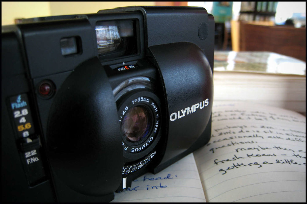 Best bang for your buck and therefore Ian's choice as top snapper is the Olympus XA, introduced in 1979. It can still be picked up for £40-£50. Image Gene Wilburn / Flickr via DigitalRev.com