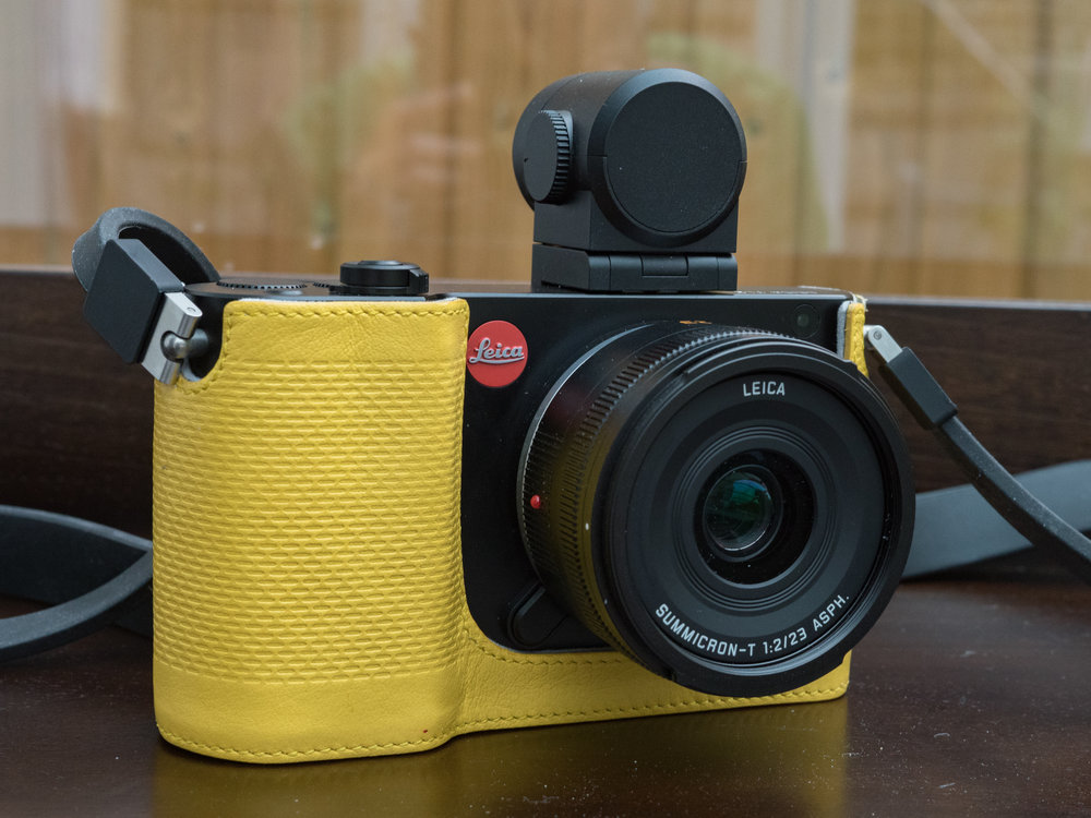 Who's a pretty birdie then? This canary yellow leather protector case came with the test camera and it was a well-made and very practical accessory. Pity about the colour, but a black one would have looked great. The very competent Visoflex viewfinder, an accessory, makes a pretty ugly impression on this otherwise lovely camera. The lens is the smallest and lightest native TL optic, the 23mm (35mm equivalent) Summicron-TL