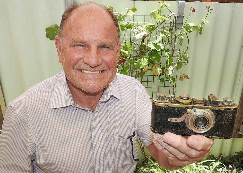 "Ashley Heuchan, formerly a well-known Perth dealer, shown here with an early ""Barnack"" Leica, just one of the items in the sale of over 1,000 pieces"