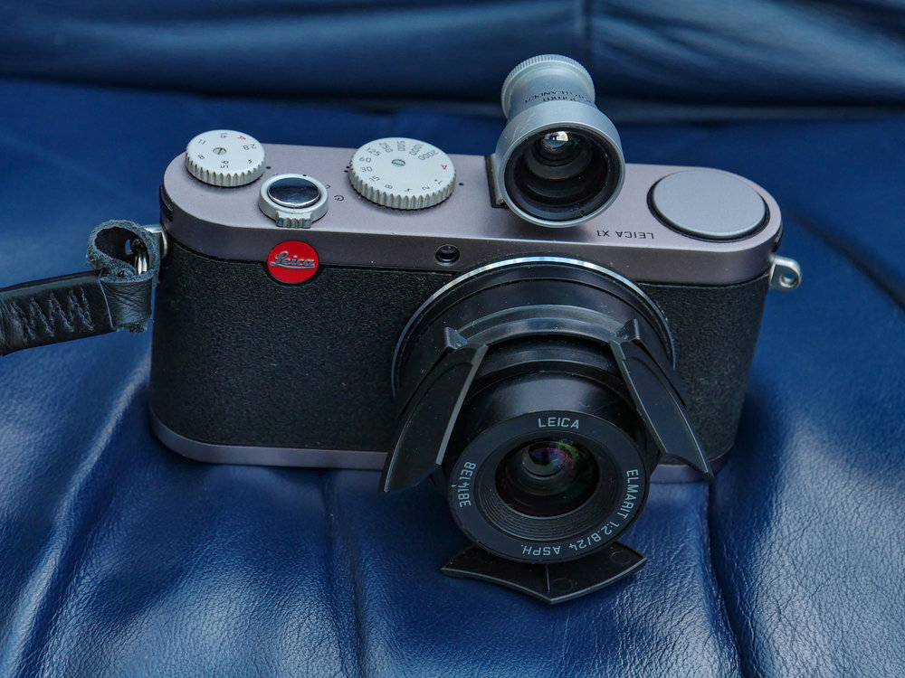 My Leica X1 is now for sale, with the automatic lens hood (an aftermarket version) but without the Voigtländer viewfinder shown here