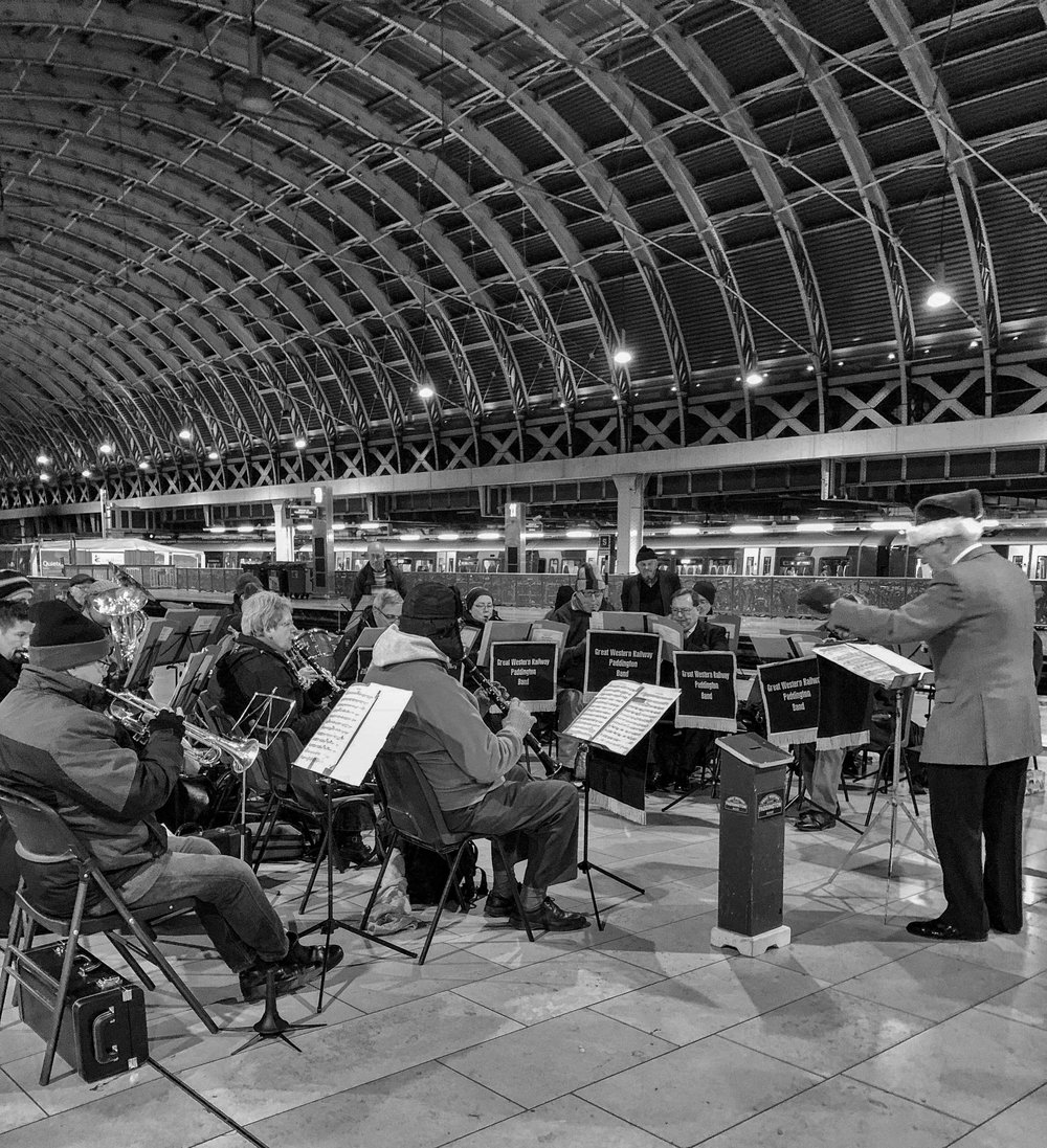 Mike Evans was surprised to find that the new iPhone X froze the movements of the Paddington Station Band even at a leisurely 1/6s and f/1.8. (B&W conversion in Silver Efex Pro)