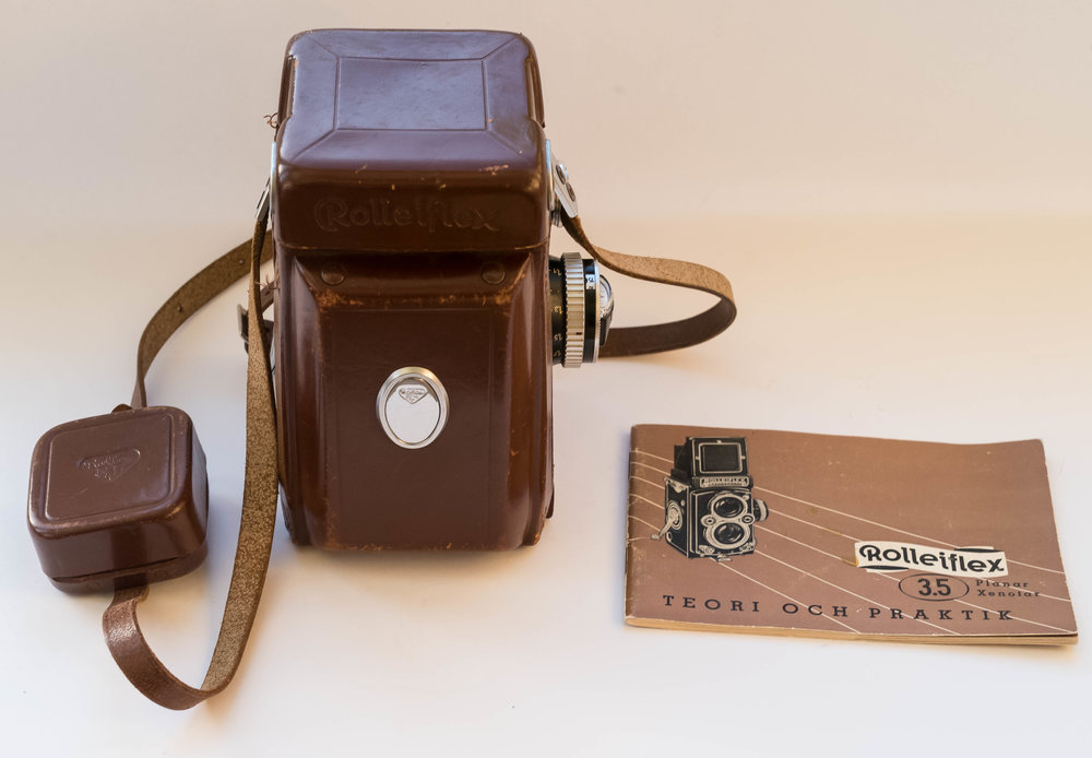 The camera itself was in superb cosmetic and mechanical condition. I also got a leather case with the auction lot, but, in truth, and unlike the camera, it was not in very good shape. In this photo the camera is holding the case on. The little pouch on the strap contained a lens hood and a filter but none of these was the right bayonet fit. Rolleiflex cameras have a bewildering range of bayonet fits for such accessories. I have some Rollei filters in a drawer, but I have not tried them on, as I don't really believe in using filters on any type of lens. The real gem here is the strap with what I can only describe as a 'scissors bayonet', which can be clipped in and out very quickly. It beats most of the nonsensical rings on straps I have seen. I don't know why it did not catch on. Perhaps, it is something to do with the shapes of camera bodies. On the right is the camera manual, which in this case is in Swedish. Fortunately, the manual can be downloaded from the  Orphan Cameras  website. Mike Butkus, the owner of the site, quite rightly expects a small contribution for downloads.