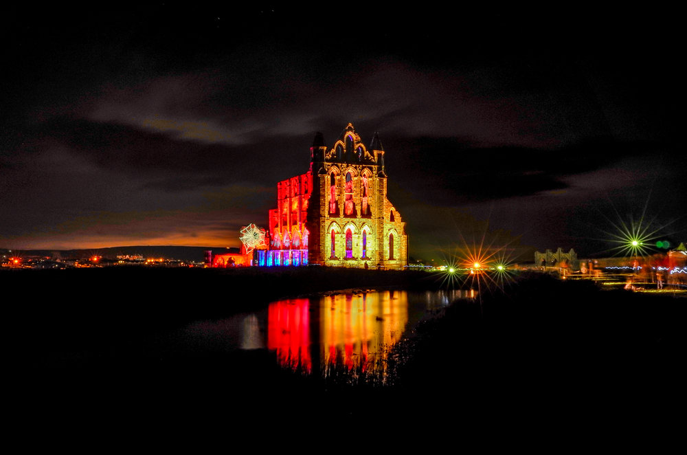 A long exposure night shot at  Whitby Abbey  during the  Goth Week  illuminations for Halloween in October 2017