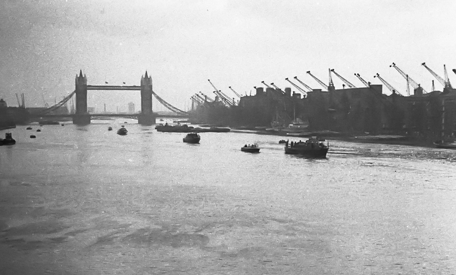 January 30, 1965, and the State Funeral barge carrying   Sir Winston Churchill's coffin makes its way from the Tower to Waterloo. I was there on London Bridge to record the river journey to Waterloo (see today's scene below)